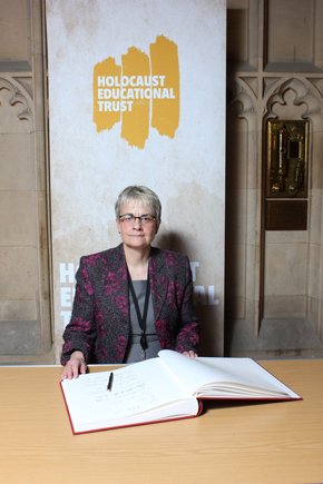 South Down MP Margaret Ritchie signs the Holicaust book at Westminster.