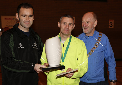 Fermanagh Cross Country winner: L to R David Somerville of Enniskillen AC presenting winner Stephen Duncan with his trophy whle Gerry Lynch, President of Athletics NI looks on.