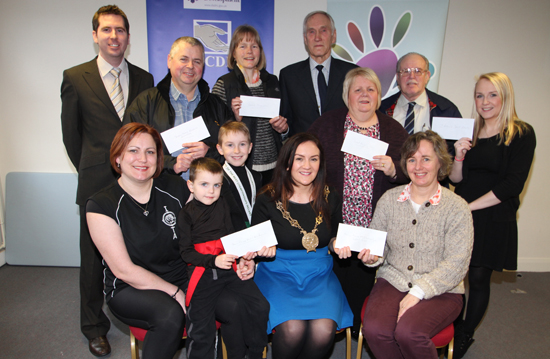 Back row, Johnny McShane, LCDI Grants Coordinator; John Gordon, Stream Street Residents' Accociation; Doris Noe and Bill Corry, Lecael Conservation; Linda Baker, Good Morning Down; Liam Rafferty, St Miquel Youth Band, and  (Sally Burch,  Newry & Mourne ME/Fibromyalgia Support Group; Fiona Patten – Down Chinese Martial Arts Association; Linda Baker – Good Morning Down; Doris Noe, William Carry – Lecale Conservation; Liam Rafferty – St Miguel Youth Band; John Gordon – Stream Street Residents Association; Roisin Doran – County Down Rural Community Network; Cllr Maria McCarthy – Chair of Down District Council) and Roisin Doran, County Down Rural Community Network. Front row, Joan McParland with Lorcan and Cain Turner of the Down Chinese Martial Arts Association; Cllr Maria McCarthy, Chair of Down District Council,. Sally Burch, Newry & Mourne ME/Fibromyalgia  Group.