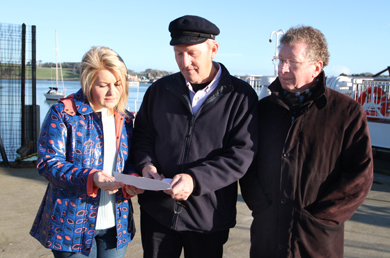 Checking over the letter from the DRD were Naiomi Ballie, Sinn FŽin Downpatrick election candidate, pictured with Dairmuid Reaordon, Chairman of the Strangford Village Association and local resident, Clifford McClenaghan.