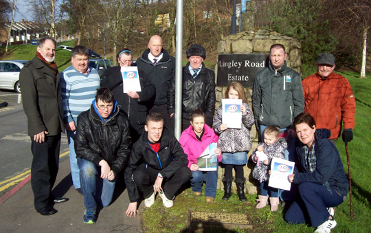 Twenty is plenty: Councillors Garth Craig and Billy Walker pictured at the Langley estate in Ballynahinch with Andrew Steenson, Chairman of the Langley Road Community Association and local residents.