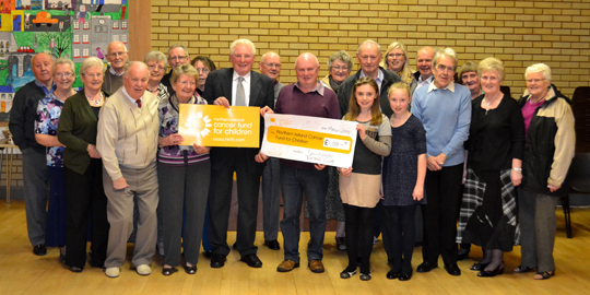 Northern Ireland Cancer Fund for Children volunteer, Jonny Hewitt from Ballygowan, is pictured accepting a cheque for £1000 from Chairman of Ballygowan Vintage Club, Trevor Harper, in memory of his late father, Harvey. Included are  Anna Wilkinson (NICFC Fundraiser). From left to right: Jonny Hewitt, Ana Wilkinson, Trevor Harper.