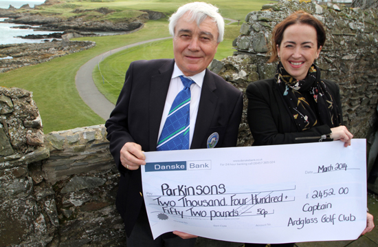 2013 Ardglass Golf Club Captain Sean Murnin presents a cheque for £2452  to Nicola McClure, fundraising manager for Parkinsons NI. The funds were raised during his Captain's Day last July.