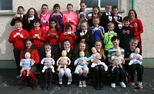 Pictured are Lifesaving Instructor Lisa McTeer with the pupils from St. Patrick's and St. Joseph's Primary Schools.