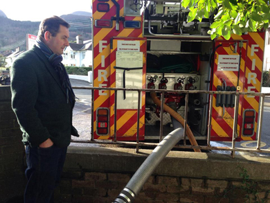 Cllr Clarke pictured at the location where earlier this year the Fire Service had to be called to help alleviate flooding to local homes.