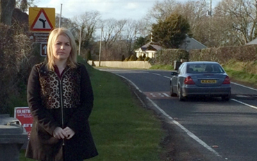 Sinn Féin local election candidate Naomi Bailie pictured at the Ballydugan Road, where re-surfacing is due to take place.