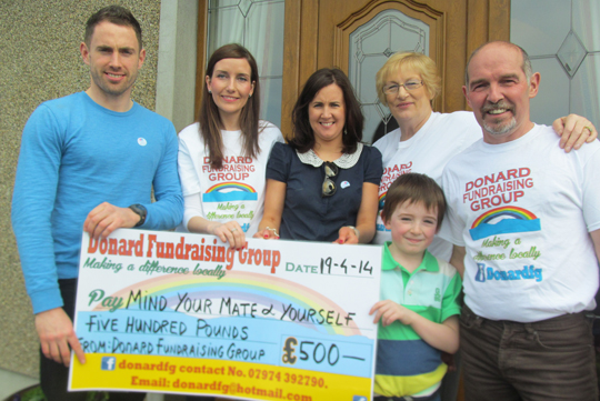 Ray Cunningham (MYMY), Shauna Goodall (Donard FG volunteer), Roseleen McCann (MYMY), Alice Anderson (Donard FG volunteer) and Paul Madden (Donard FG Chairman) with his young son Raphael Madden.