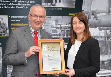 Transport Minister Danny Kennedy presents Laura Carse, from Killinchy, PhD in Civil Engineering, Queen's University with the William Bald Bursary