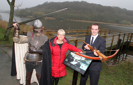 At the Quoile Pondage near Downpatrick were actor Mark Davis, who played a Stark Guard in the Game of Thrones, with South Down MP Margaret Ritchie and Environment Minister Mark H Durkin at the unveiling ot the Game of Thrones signage by the stand built for the filming for the popular series last year.