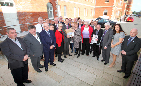 Local health campaigners and politicians hand over the 20,000 signature petition to Health MInister Edwin Poots.