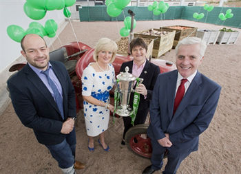 Enterprise, Trade and Investment Minister Arlene Foster and Ulster and Ireland star Rory Best, complete with the RBS 6 Nations trophy, congratulate Mash Direct Managing Director Martin Hamilton and Director Tracy Hamilton at an event to celebrate the company's 10th anniversary.
