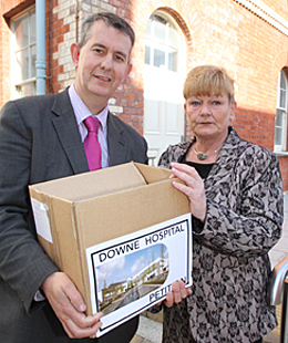 Health Minister Edwin Poots receives over 20,000 signatures from Anne Trainor who co-ordinated a group for the Down Community Health Committee that gathered the signatures across Down District.