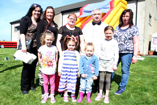 Nuala Mulholland, Jennifer Davey, Assistant, Tiny Toons Leader, with Patricia Curran, Chairperson, Noel Curran Director, and Karen Fitzsimons, Assistant, and some of the children enjoying the fun day in Bishopscourt.