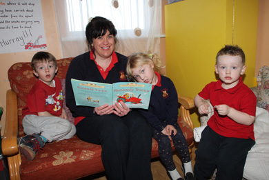 Nuala Mulholland, Tiny Toons Leader in Charge, reads a story in the Reading Room.