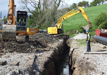 NI Water at work digging out the pipelines beside the Downpatrick and County Down Railway.