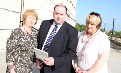 Unison officials Marion Ritchie and Sonya Graham pictured with Eamonn McGrady, chairman of the Down Community Health Committee, on the steps of Parliament Buildings at Stormont befote the Adjournment Debate on the Down Hospital A&E Minor Injuries Unit.