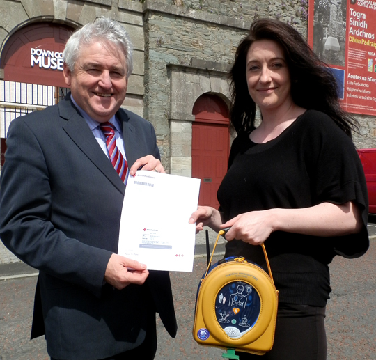 Downpatrick Lions President Brenbdan with Anne Kelly of Down County Museum.