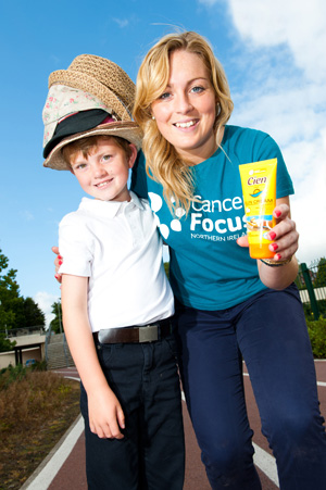 Finbar Mallon (6) of Cumran Primary School in Clough pictured with Niamh McDade, Cancer Focus cancer prevention officer.