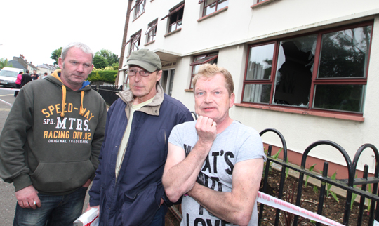 Michael Graham, Michael McKinney, and Ciaran McPoland, three residents of McLaughlin Builing forced out of their homes due to a suspected arson attack in Downpatrick's Saul Road.