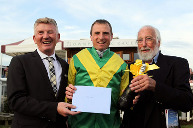 Jamie Codd, the new All-Ireland Champion point-to-point rider received a presentation from Downpatrick Racecourse with Manager Richard Lyttle (left) and Course Director,Brian Nicholl (right).