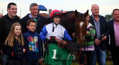 Happy local connection. Downpatrick trainer Brian Hamilton and rider Lisa O'Neill with connections pictured after Big Kern's victory in the bumper with Philippa Baird at the horse's head.