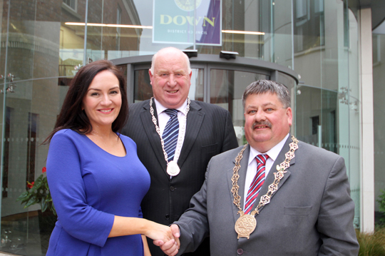 Outgoing Chairman of Down District Council, Cllr Marie McCarthy, hands over to the 2014-15 chairman Cllr Billy Walker. Included is the new Council  Vice-chairman Cllr Desmond Patterson.