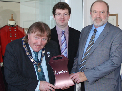 Current volunteer, Jackie Dodds (right), photographed with former Deputy Mayor of Newry and Mourne District Council, Cllr. Brian Quinn, and Dr Robert Whan (centre).