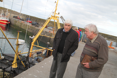Newry Mourne and Downe District Councillor Dermot Curran at the harbour in Ardglass with NIFPO Chief Executive Dick James.
