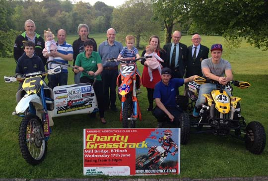 MMC charity group: back row – Richard Portis, Nigel Hamilton holding his daughter Emma, Noel Burrows, Mourne club Chairman Billy McLarnin, Patricia Hamilton holding her daughter Katie, with Richard Scott and Jimmy Brewster from Ballynahinch Lions. Front row – Adam McMullan along with Joanne Young from Macmillan Nurses on the sidecar, Ryan Hamilton on the solo motorbike, with Justin Kirk and Dean Colhoun on the quad.