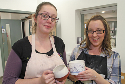 Potter Helen Faulkner, incoming resident artist, and ceramacist Aine McKenna, outgoing resident artist,  at the Down Arts Centre in Downpatrick.
