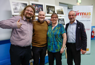 Adrian Lines, MPAGB FBPE, is pictured at the event with Paul Nugent from firmus energy and Ballynahinch Camera Club members, Frances Price and Terry Hanna.