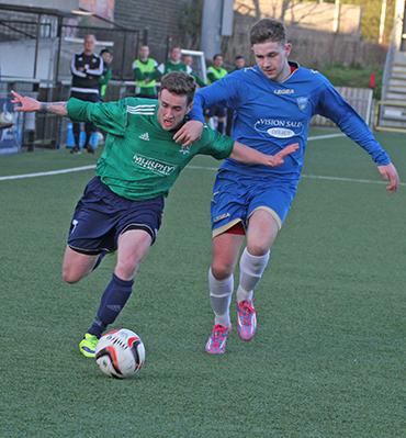 Barry Treacy battles with Lisburn Rangers defender