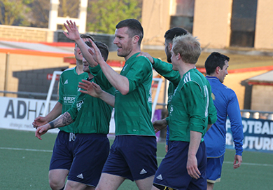 Downpatrick's Peter Telford celebrates after heading his side into the lead in the first half against Lisburn Rangers.