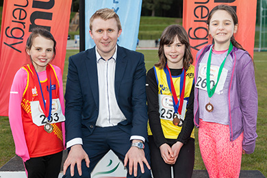 Mini Girls 150 metres Pictured with Philip Hewitt of firmus energy at Meet 2 of the firmus energy 2016 Super Six series are Niamh Fenlon (2nd right) from North Down Athletic Club; Lauren Madine (left) from East Down Athletic Club in Downpatrick and Poppy Dann (right) also from North Down Athletic Club who came first, second and third respectively in the Mini Girls 150 metres.