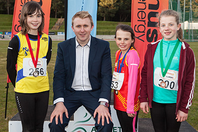 Mini Girls long jump Pictured with Philip Hewitt of firmus energy at Meet 2 of the firmus energy 2016 Super Six series are Lauren Madine (2nd right) from East Down Athletic Club in Downpatrick;  Niamh Fenlon (left) from North Down Athletic Club and Stephanie Bell (right) from Armagh Athletic Club who came first, second and third respectively in the Mini Girls Long Jump.