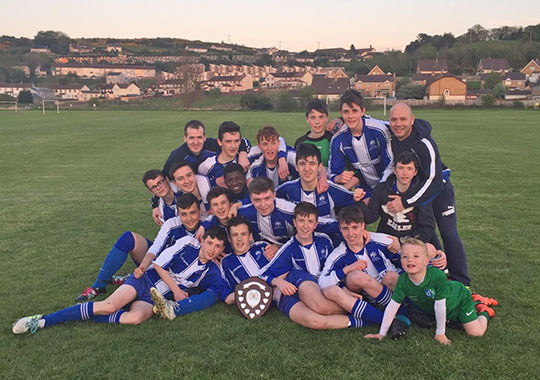 The winning Patrician team with managers
