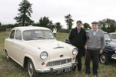 Ballykinler men PJ Doran chats to Malachy Clendinning, the owner of the 1954 Austin Cambridge.