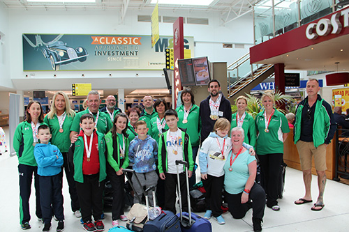 The group returns to Belfast City Airport.