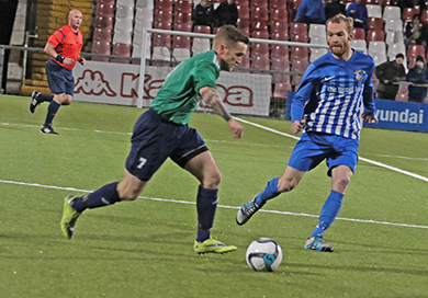 Downpatrick's Barry Treacy pressing forward in midfield against Immaculata.