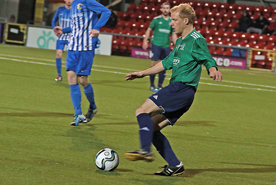Philip Traynor whips a left footer at the Immaculata goal over the defence to put his side two up.